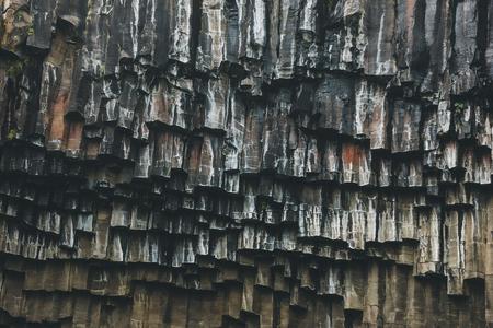 full frame image of black basalt column formation of Svartifoss in Iceland