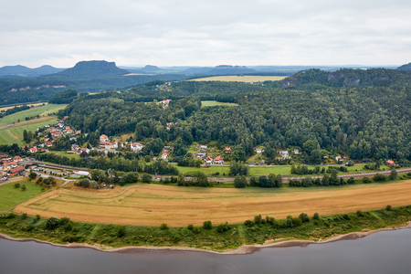 aerial view of beautiful elbe river, fields and small town in Bad Schandau, Germany Standard-Bild - 109847541
