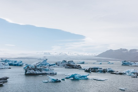 scenic shot of blue ice pieces floating in lake in Jokulsarlon, Iceland
