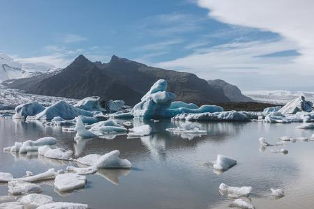 melting glacier ice floating in lake in Fjallsarlon, Iceland