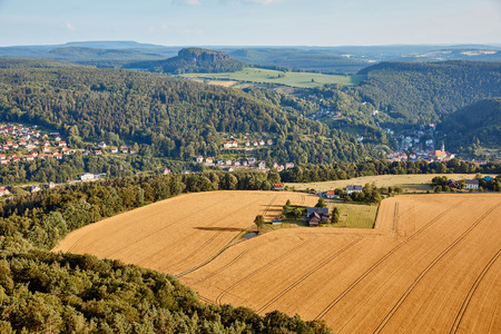 aerial view of agricultural fields near village and mountains in Bad Schandau, Germany