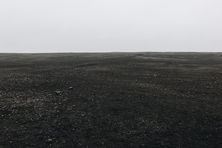 full frame image of black sand beach against cloudy sky in Solheimasandur, Iceland Stock Photo