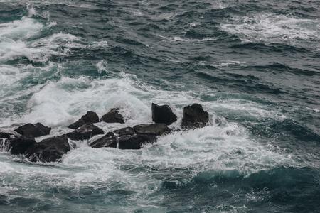 dramatic shot of ocean waves crashing on rocks for background Stock fotó