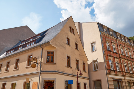 low angle view of  buildings with windows and cloudy sky in Bad Schandau, Germany Standard-Bild - 109919895