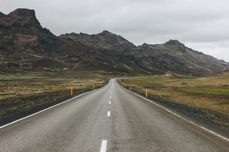 empty asphalt road in Iceland with beautiful mountains on background