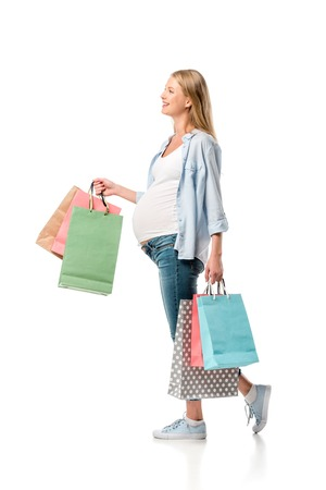 cheerful pregnant mother holding shopping bags isolated on white Foto de archivo - 109920626