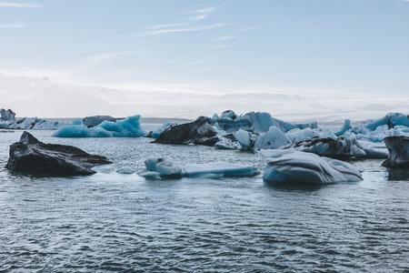 dramatic shot of glacier ice pieces floating in lake in Jokulsarlon, Iceland Reklamní fotografie