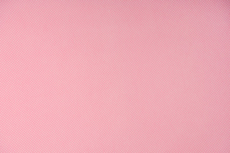 top view of white polka dots on pink background 스톡 콘텐츠