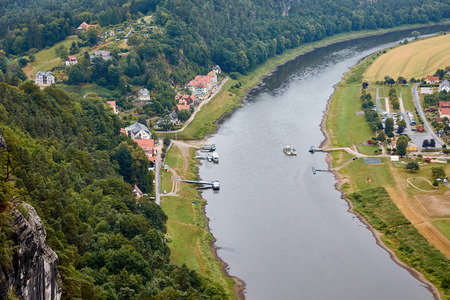 aerial view of boats on elbe river, fields and small town in Bad Schandau, Germany