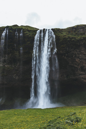 scenic view of landscape with Seljalandsfoss waterfall in highlands in Iceland