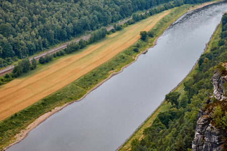 aerial view of beautiful elbe river, field, forest and rocks in Bad Schandau, Germany