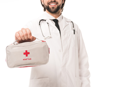 cropped shot of smiling doctor holding first aid kit isolated on white Banque d'images - 109924000