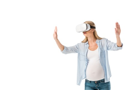 expressive pregnant woman in virtual reality headset gesturing with hands isolated on white