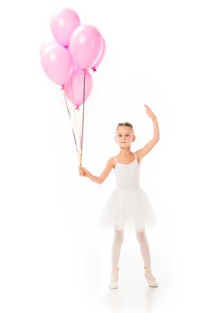 Little ballerina in tutu dancing with pink balloons isolated on white background
