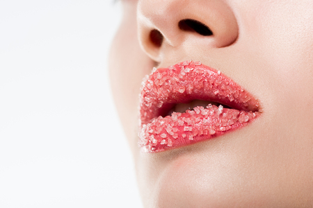 Cropped view of woman with sugar on pink lips, isolated on white 免版税图像