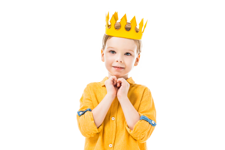 Adorable boy in yellow crown with please gesture, isolated on white