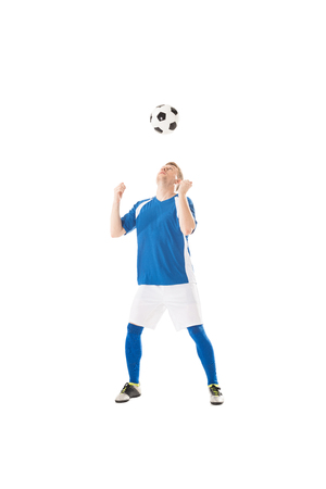 Full length view of handsome young soccer player training with ball isolated on white Stok Fotoğraf