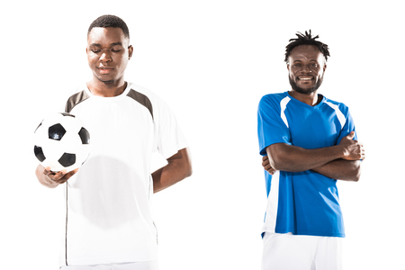 Smiling athletic young african american soccer players standing isolated on white