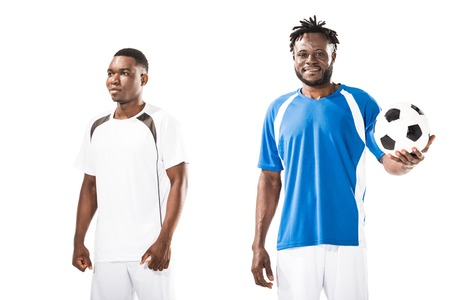 Athletic young african american sportsmen standing with soccer ball isolated on white 写真素材
