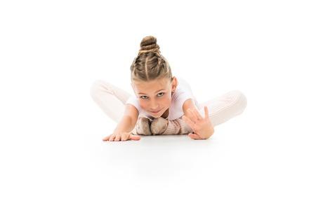 Kid practicing gymnastics exercises isolated on white background Stock Photo