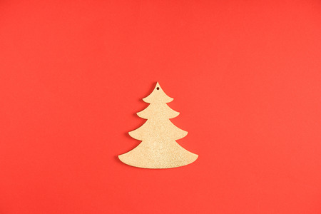 Close-up view of decorative fir tree symbol on red background Stock Photo