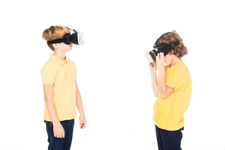 cute little boys using virtual reality headsets isolated on white