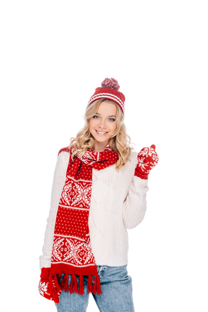 beautiful young woman in hat, scarf and mittens smiling at camera isolated on white Stock Photo