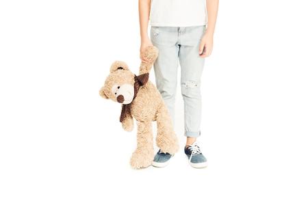 cropped image of child holding teddy bear isolated on white Stock Photo