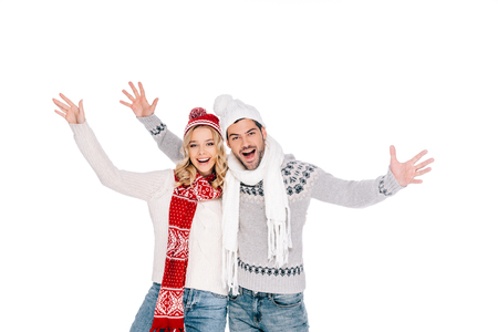 cheerful young couple in winter outfit smiling at camera isolated on white Stock Photo