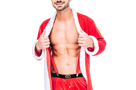 cropped image of muscular man in santa claus costume showing torso isolated on white background Stock Photo