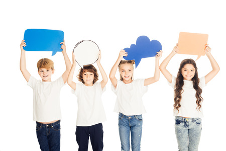 adorable children holding paper speech bubbles above heads isolated on white