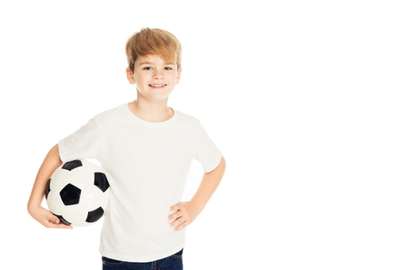 smiling adorable boy holding football ball and looking at camera isolated on white Stock Photo