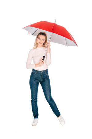 beautiful young woman holding red umbrella and smiling at camera isolated on white
