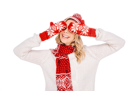 beautiful smiling young woman in red mittens closing eyes isolated on white