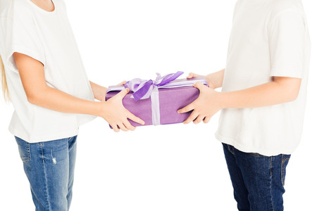 cropped image of boy presenting gift box to friend isolated on white Stock Photo