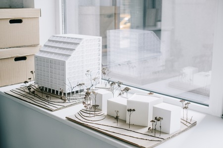 white architecture models on windowsill in light modern office