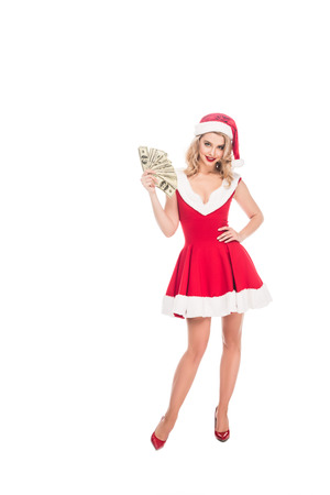 seductive santa girl in christmas hat holding dollar banknotes isolated on white