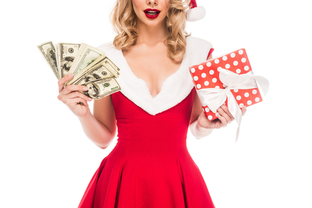 partial view of santa girl in christmas hat holding cash money and gift box isolated on white Stock Photo