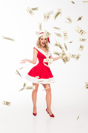 excited santa girl in christmas hat throwing out cash money isolated on white Standard-Bild
