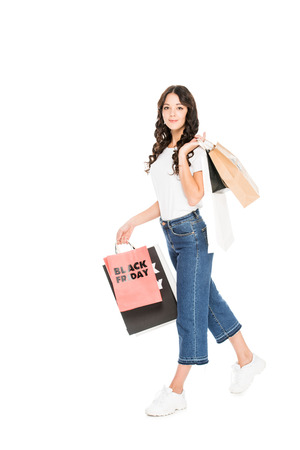 shopaholic holding shopping bags with black friday sale signs isolated on white