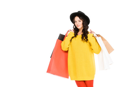attractive girl holding shopping bags, isolated on white Stockfoto