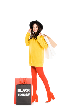 fashionable girl holding shopping bags on black friday sale, isolated on white