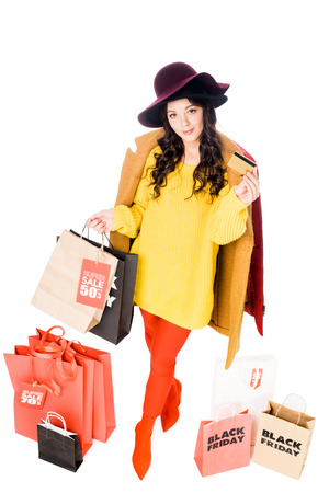 beautiful girl holding credit card and shopping bags for black friday isolated on white Stockfoto