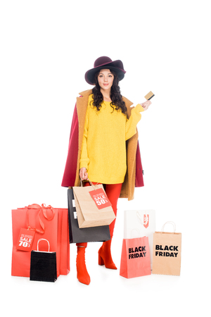 attractive girl holding credit card and shopping bags for black friday isolated on white Stockfoto