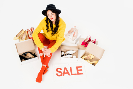 beautiful shopaholic with sale symbol isolated on white with footwear Stockfoto