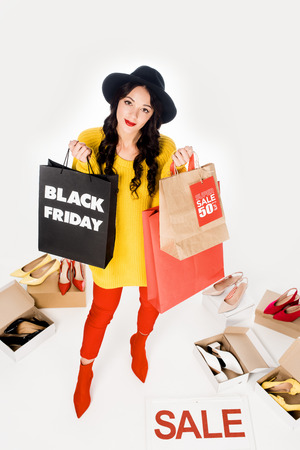 holding shopping bags with black friday Stockfoto