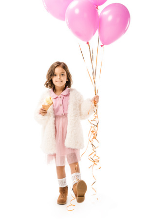 Beautiful happy child with pink air balloons and ice cream isolated on white background Banco de Imagens