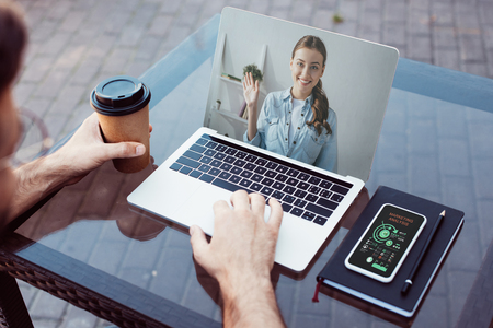 Cropped image of man taking part in webinar with laptop Stock Photo - 110352258