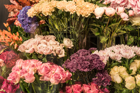 Beautiful colorful roses and carnation flowers at flower shop