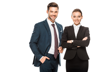 Successful young business partners in stylish suits looking at camera isolated on white background